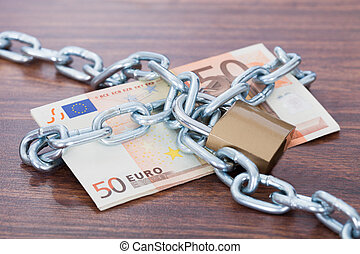 Euro Notes With Chain And Padlock On Table