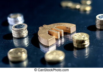 Euro symbol and coins.
