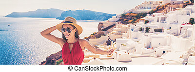 Europe travel luxury cruise vacation destination tourist woman in Santorini, Oia, Greek Islands, Greece, Europe. Girl on summer holiday having fun walking in white village. Banner panorama.