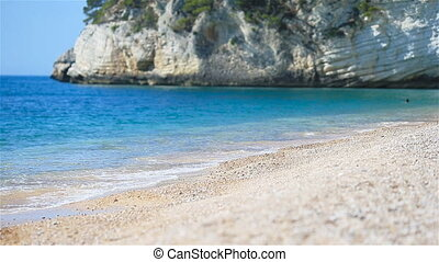 European beach with turquoise water in the sea