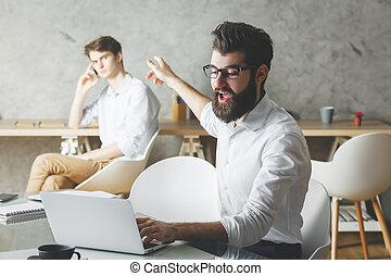 European businessman using laptop