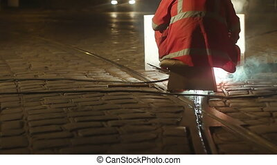 European Caucasian man fixing the rails