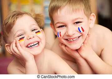 European children - Cute little brother and sister with...