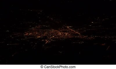 European city at night. View from the plane.