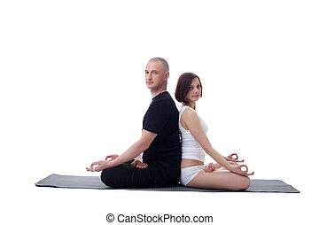 European couple doing yoga in studio