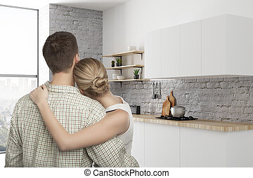 European couple in kitchen