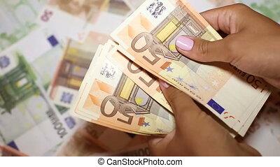 European currency in female hands - Currency in women's...