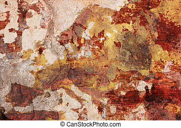 european decay - chipped plaster of dirty painted wall with...