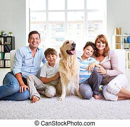 European family - Family of four sitting on carpet