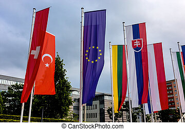 european flag and other flags, symbolism of diplomacy and...