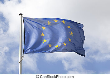 European flag flowing in the wind over blue sky