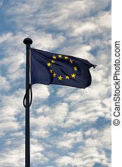 European flag waving in the wind against a clouded sky