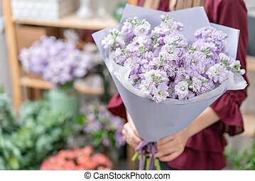 European floral shop. Two Bouquet of beautiful lilac flowers...