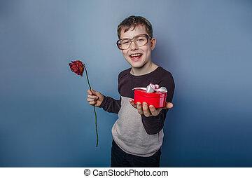 European-looking boy of ten years in glasses in hands holds ...