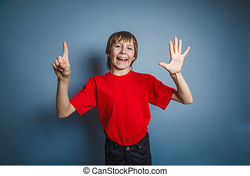 European-looking boy of ten years shows a figure six fingers...