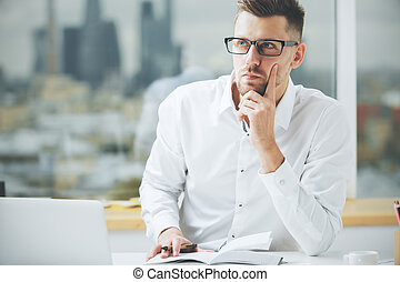 European man working on project