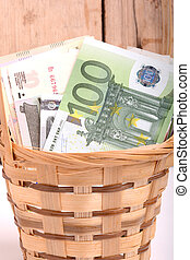 european money on wooden basket