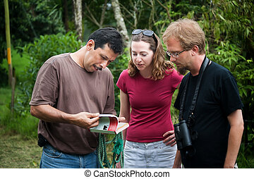 European or American tourist with nature guide in Costa Rica...