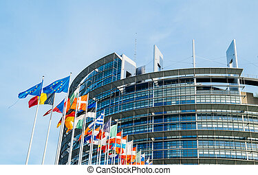 European Parliament flags in front of the main building