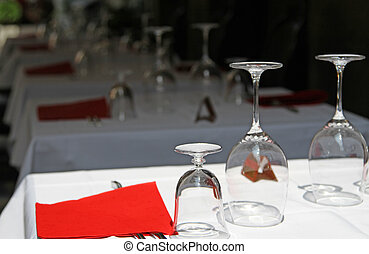 restaurant tables with crystal stemware
