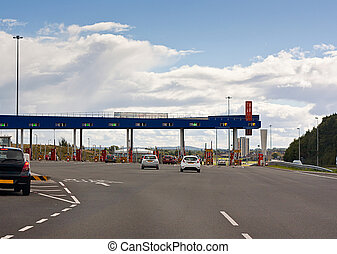european road toll gate - Cars approaching a toll gate,...