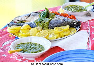 european sea bass branzino steaming potatoes tomatoes basil...