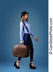 european traveller - Elegant girl model in bowler hat poses...