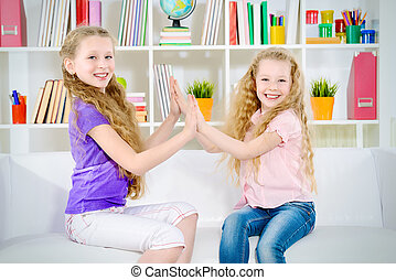european - Two beautiful happy sisters playing together at...
