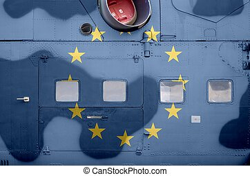 European union flag depicted on side part of military armored helicopter closeup. Army forces aircraft conceptual background