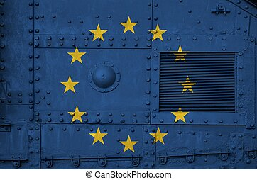 European union flag depicted on side part of military armored tank closeup. Army forces conceptual background