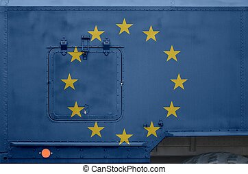 European union flag depicted on side part of military armored truck closeup. Army forces conceptual background