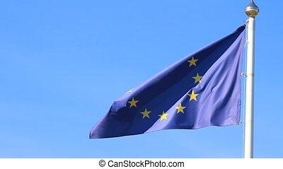 European Union flag on sky backgroun