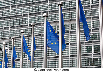 European Union flags in front of the Berlaymont building in Brussels, Belgium