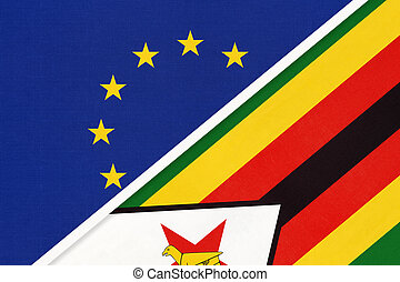 European Union or EU and Zimbabwe national flag from textile. Symbol of the Council of Europe association.