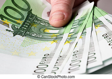Euros in hand - 100 euro banknotes in hand close up