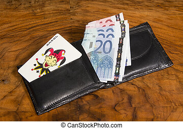 Euros with joker card in wallet