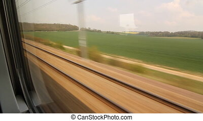Eurostar. Green field and trees.