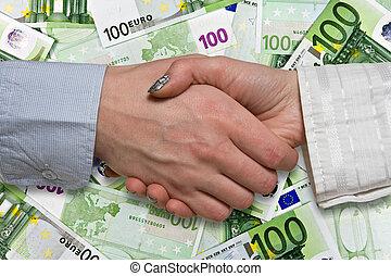 Eurozone deal concept. business handshake on euros background