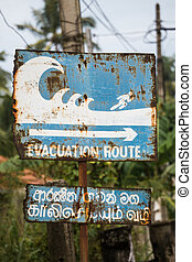 Evacuation route sign - Taken in Sri Lanka, this sign shows...