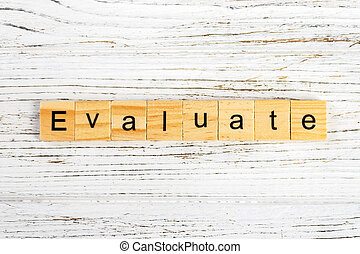 EVALUATE word made with wooden blocks concept