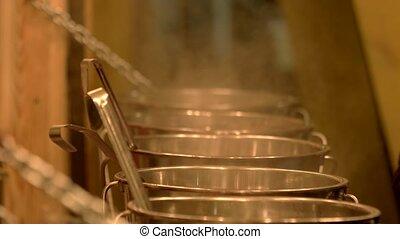 Evaporation from saucepans. Metal saucepans.