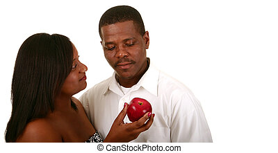 Eve Offering Apple To Adam - african american couple posing...
