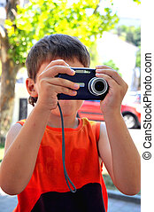 even little boy can use digital camera - Little boy holding...