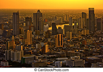 evening Bangkok Thailand - Modern skyscraper city streets in...