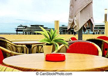 Evening cafe on the waterfront Scheveningen in The Hague. Autumn in the Netherlands, Den Haag