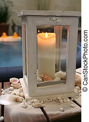 evening candle by spa bath