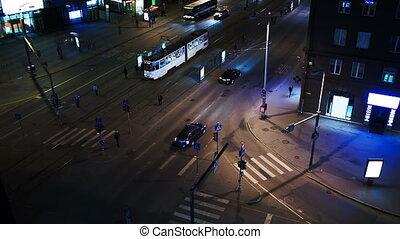 Evening city traffic in Tallin, Estonia. Crossroad with public transport stops
