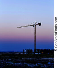 construction crane on the sunset background