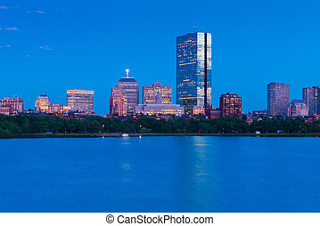 Evening cityscape of Boston, buildings in Back Bay district reflected in water, USA
