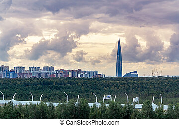 Evening cityscape. View of the Lakhta Center tower in St. Petersburg with dramatic clouds